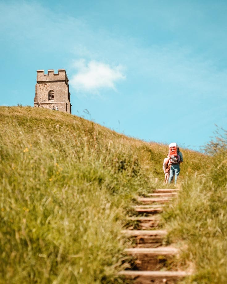 People hiking up the steps towards Glastonbury Tor