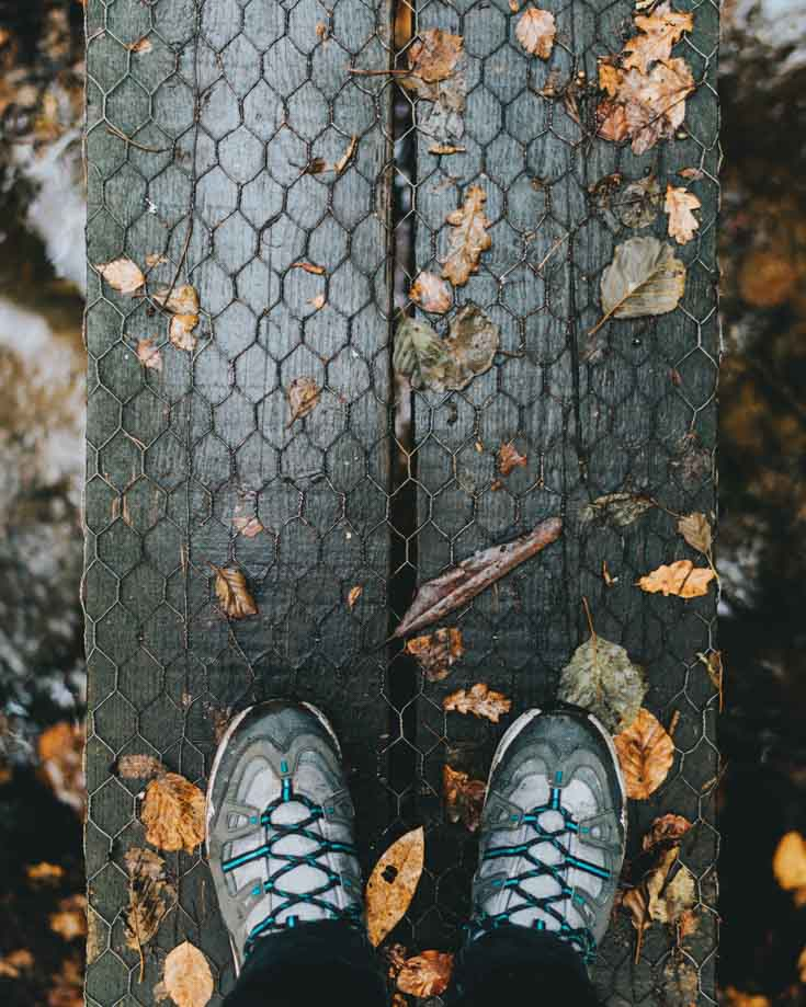 A pair of walking shoes on a wooden walkway