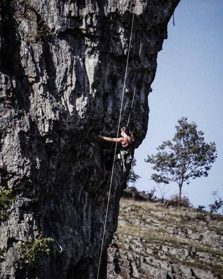A climber descending the face of the cliffs at Cheddar Gorge