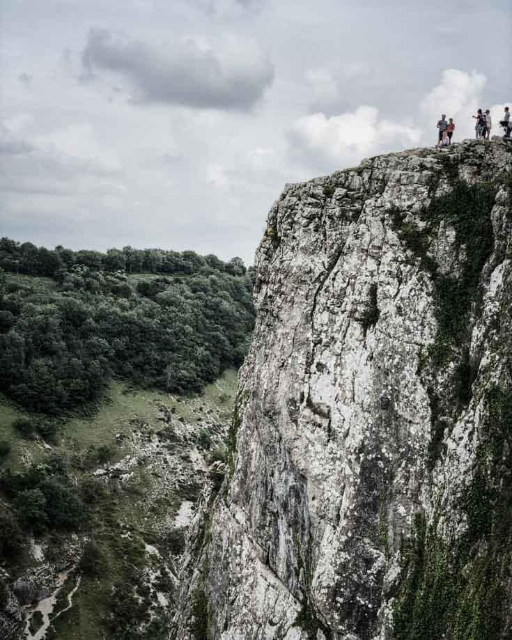 people standing at the top of cheddar gorge walks cliff top walk