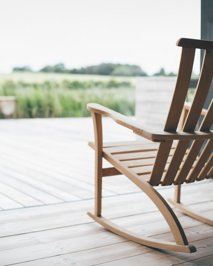 rocking chair with a view over green fields