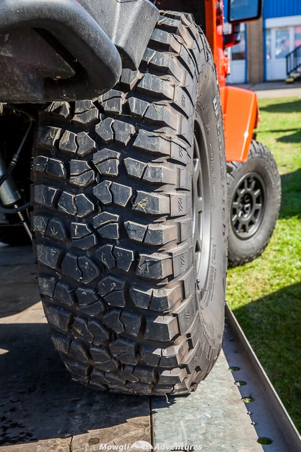 a close up of the deep tread of off road tires