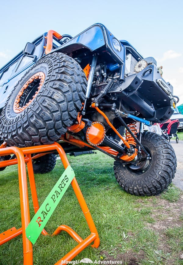 a land rover with modified suspension at an adverse angle