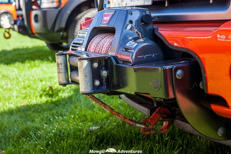 A close up of a winch fitted to a land rover