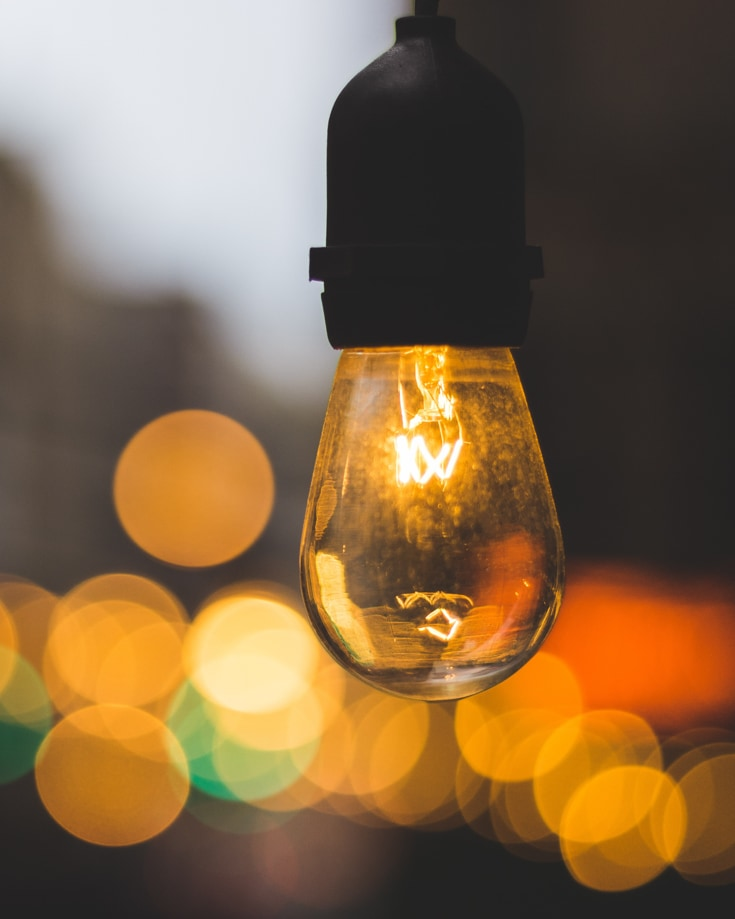 Close up of a lightbulb with bokeh light effects in the background