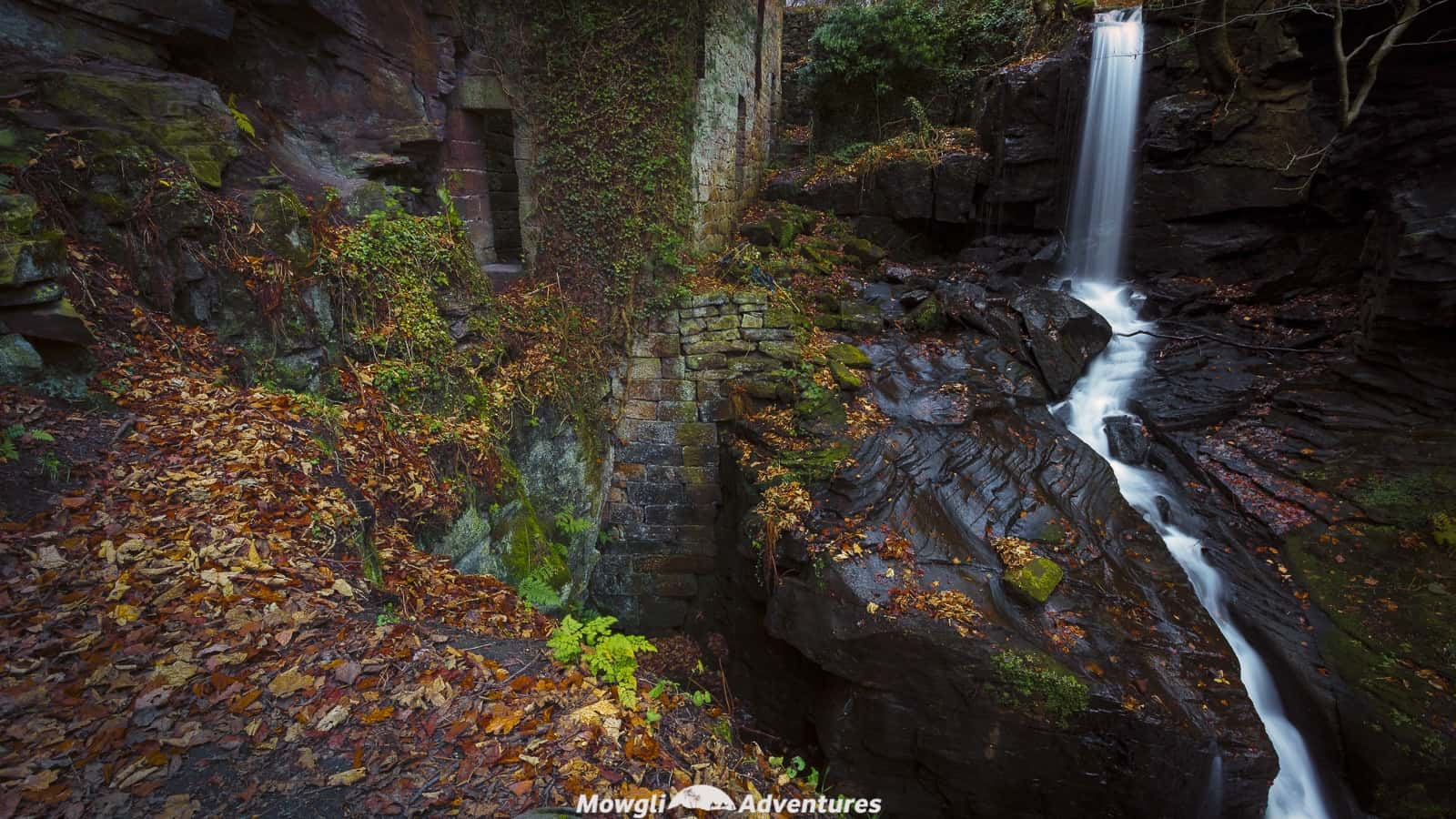 Lumsdale waterfalls cascading over rocks beside ruins