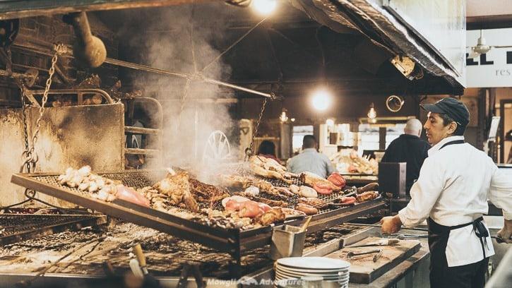 Chefs cooking aside in Mercado del Puerto