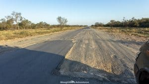 disintegrated asphalt Trans-Chaco Highway in Paraguay