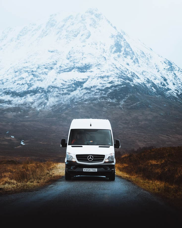 Motorhome or campervan in front of snow covered Scottish Highlands