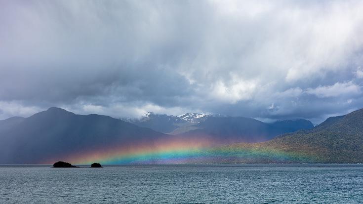 Rainbow over the fjords near Puyuhuapi