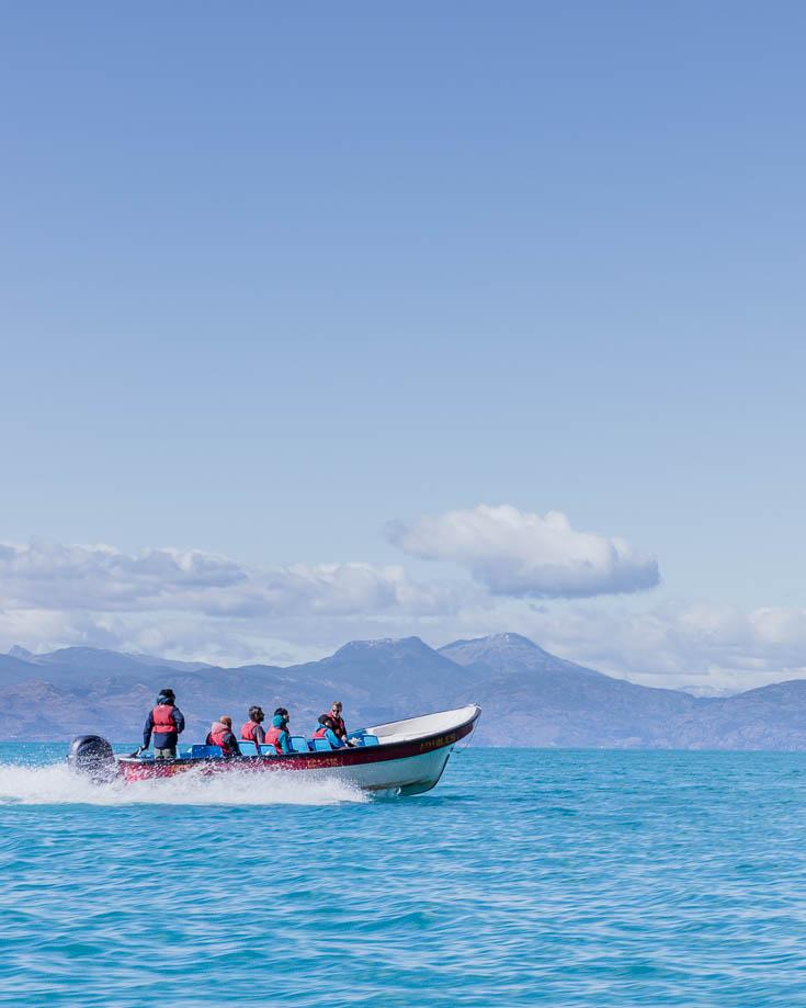 a boat motoring across the lake