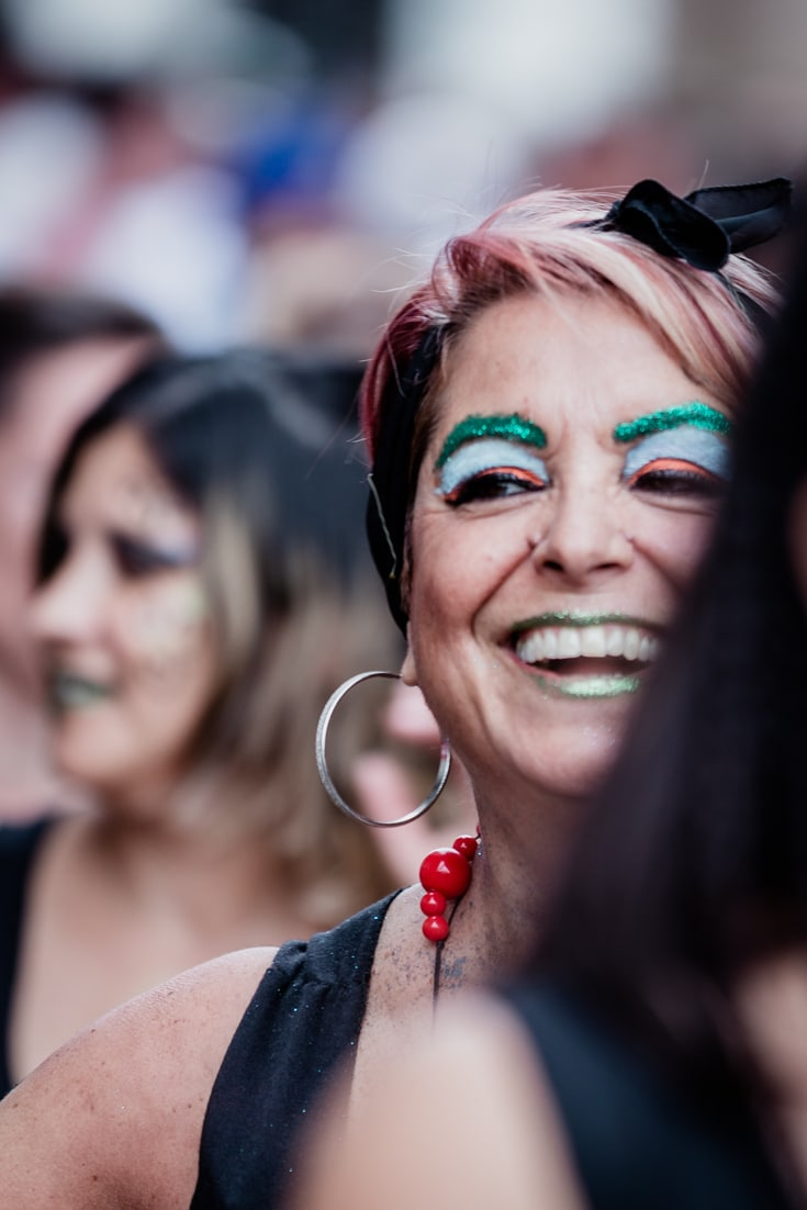 A female Candombe dancer laughing in full make up