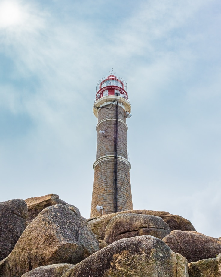 Looking up at the lighthouse on top of the rocks at Cabo Polonio Uruguay