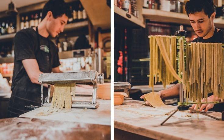 Young man making fresh pasta in San Telmo market Buenos Aires