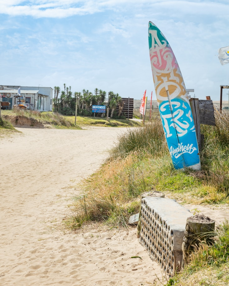 A surf board propped up outside a hostel in Cabo Polonio Uruguay