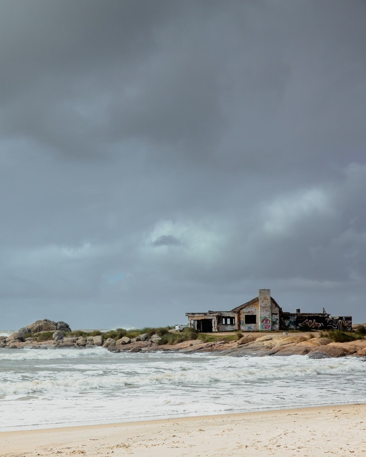Dark storm clouds over an abandoned building on a beach in winter in Uruguay