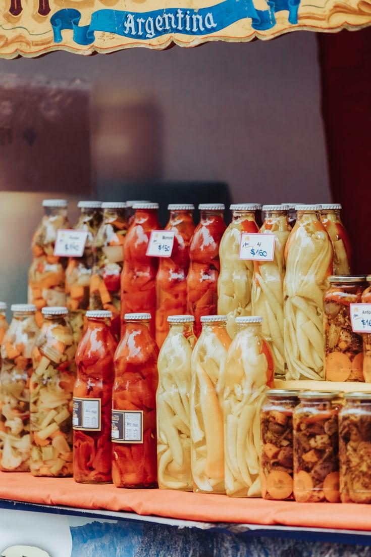 Artisanal jars of pickles at Mataderos Market