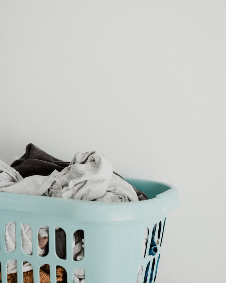 A basket of dirty laundry - campervan ventilation can help eliminate odours