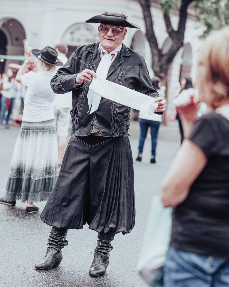 Folkloric dancer dressed in black at Feris de Mataderos Buenos Aires