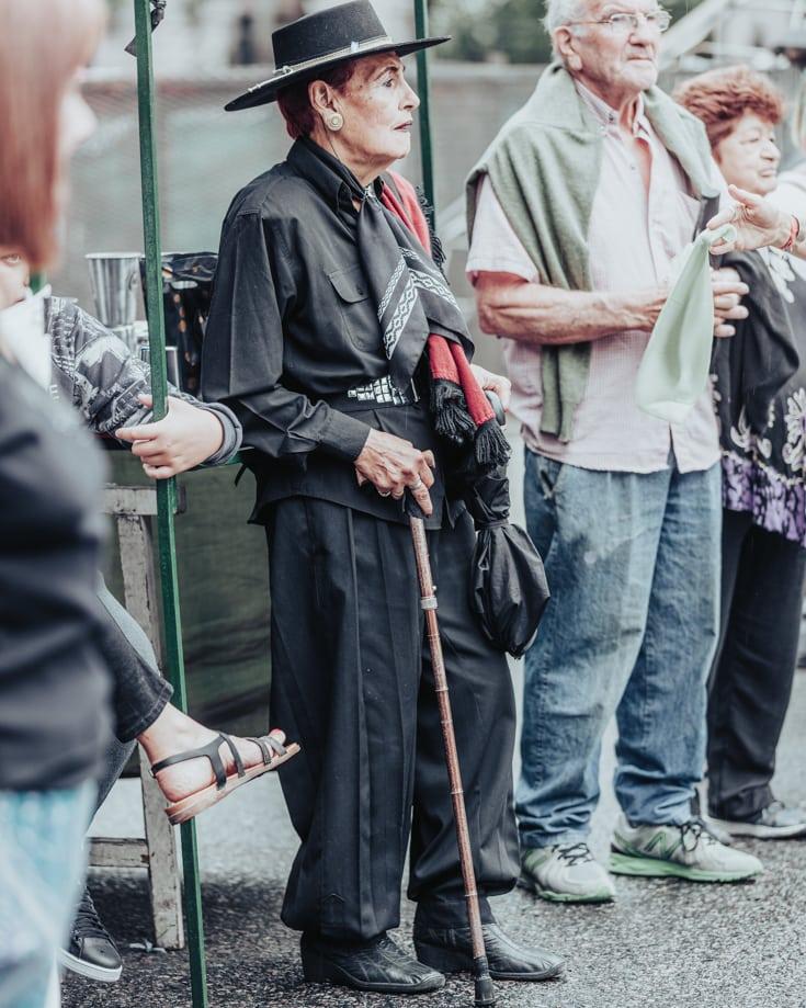 Folkloric dancer with walking stick at Feris de Mataderos Buenos Aires