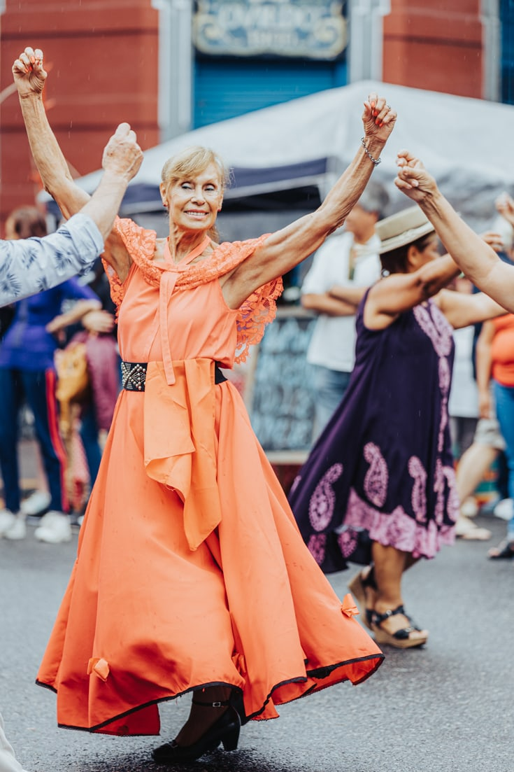 Folkloric female dancer with her arms in the air at the gaucho fair in Buenos Aires