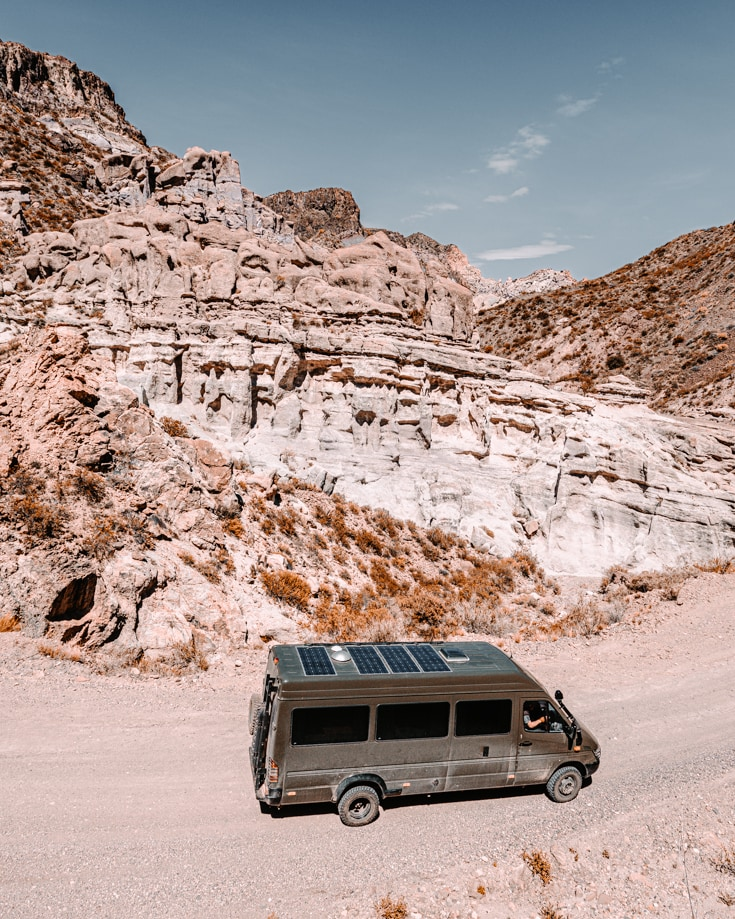 Rock formations in Atuel Canyon with sprinter camper van driving past