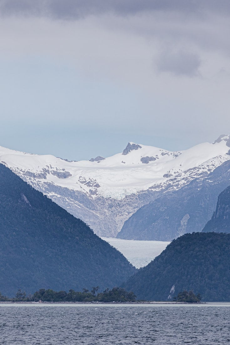 A distant glacier in the mountains on the edge of the Aysén fjords