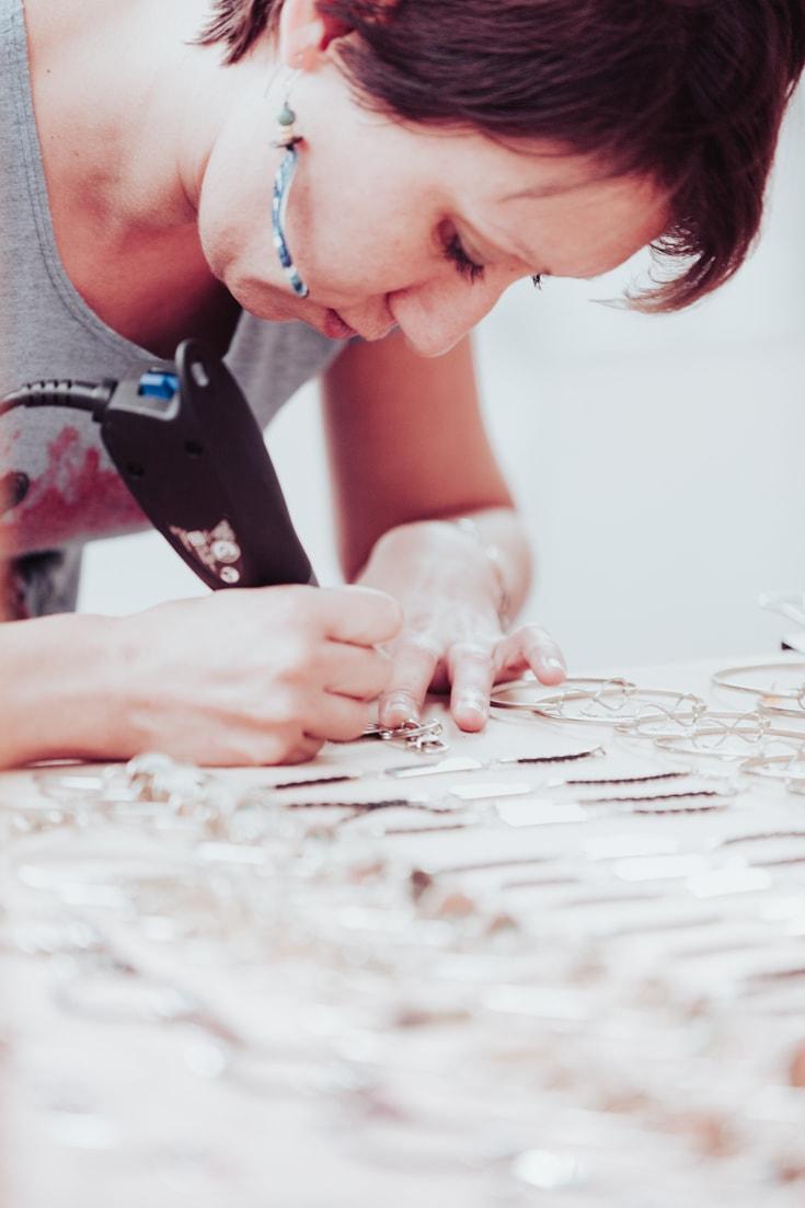 artist engraving silver jewellery