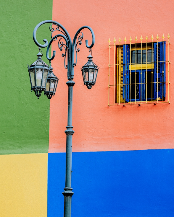 Colourfull walls and antique lamp post in La Boca Buenos Aires