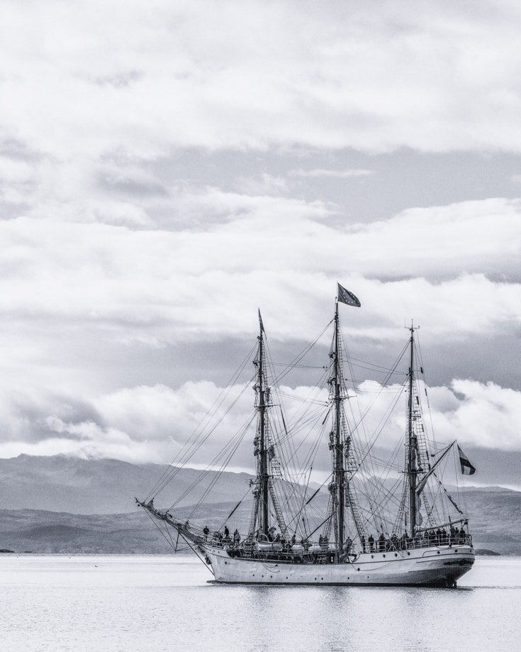 clipper ship setting sail down the Beagle channel in Patagonia