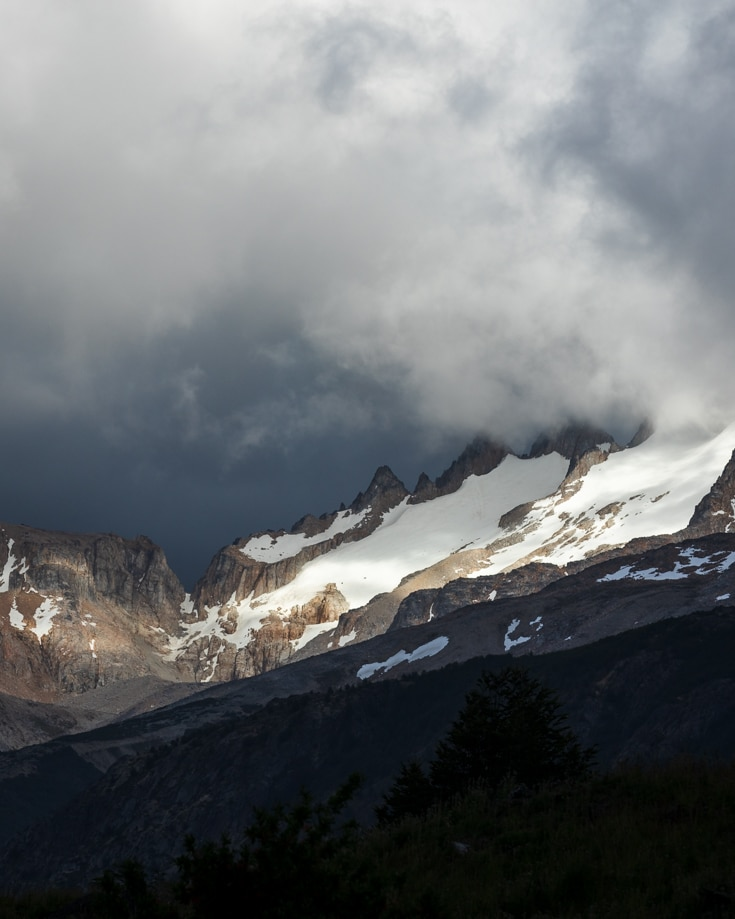 sunlight hitting th emountain peaks near cerro castillo in chilean patagonia