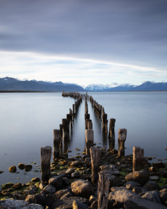 Wooden pier extending into the fjords near Puerto Natales in Chile