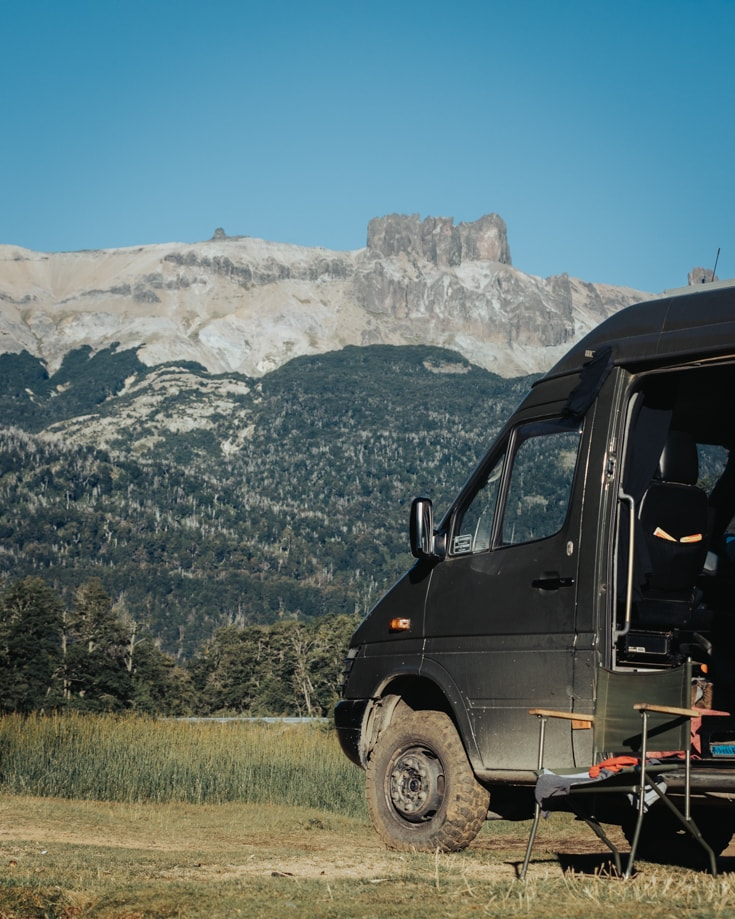 Sprinter van parked in front of mountains