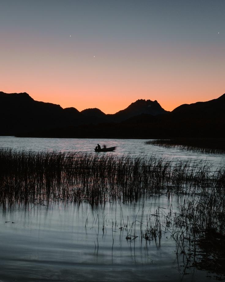 A fishing boat on Lake Vilarino at sunset