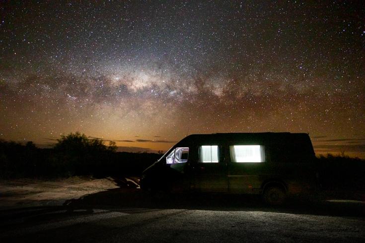 Milky way over a camping sprinter van conversion