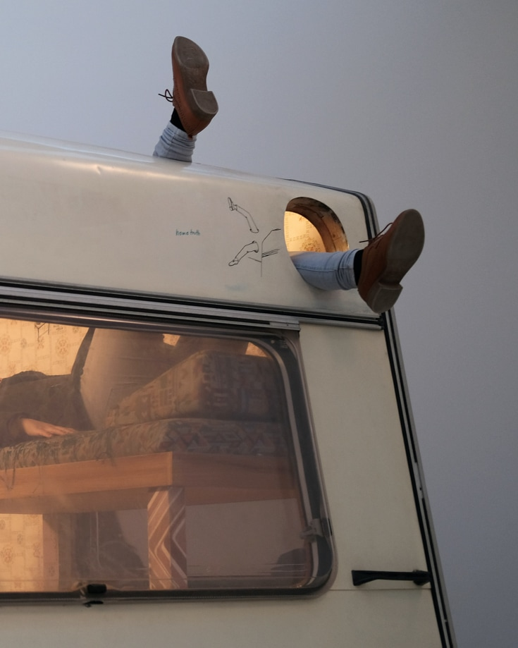 legs sticking out of a campervan