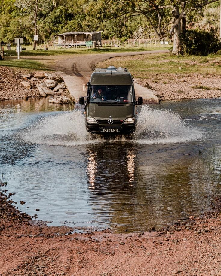 Camper van conversion driving through water