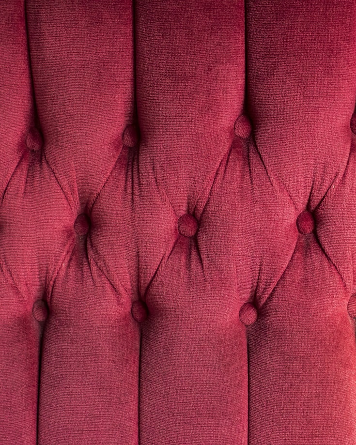 A close up of red upholstery