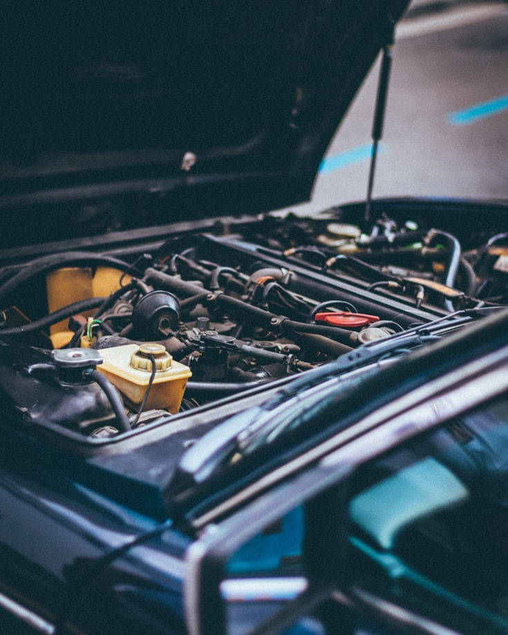 The engine bay of a vehicle with the bonnet up