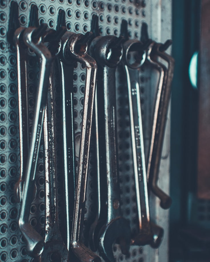 Spanners hanging up on a wall in a garage