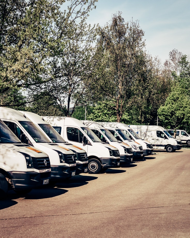 A row of cargo vans for sale