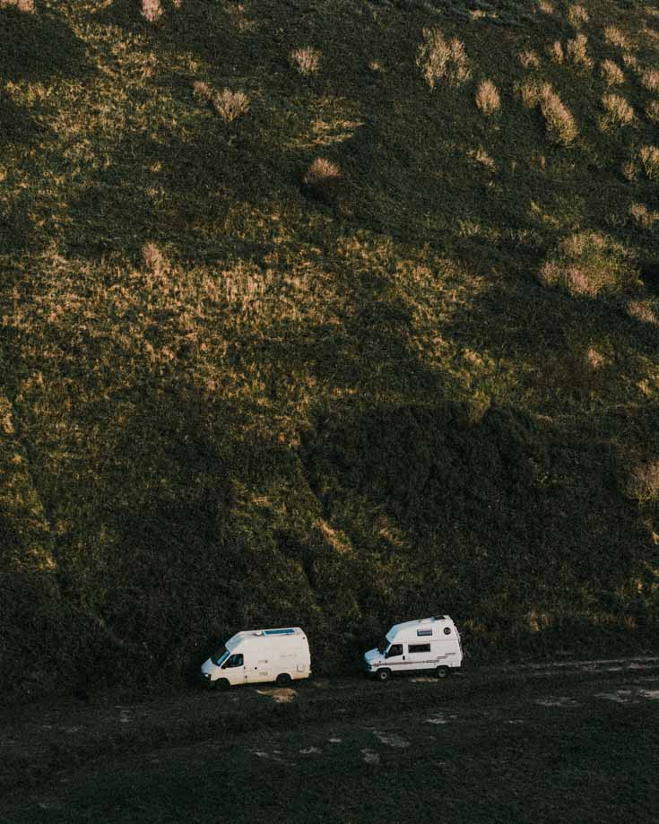 2 campervans parked in the the wilderness