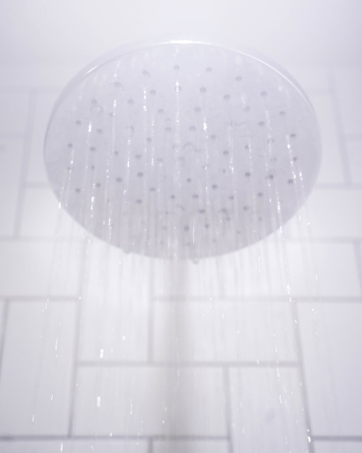 Steaming water from a shower head