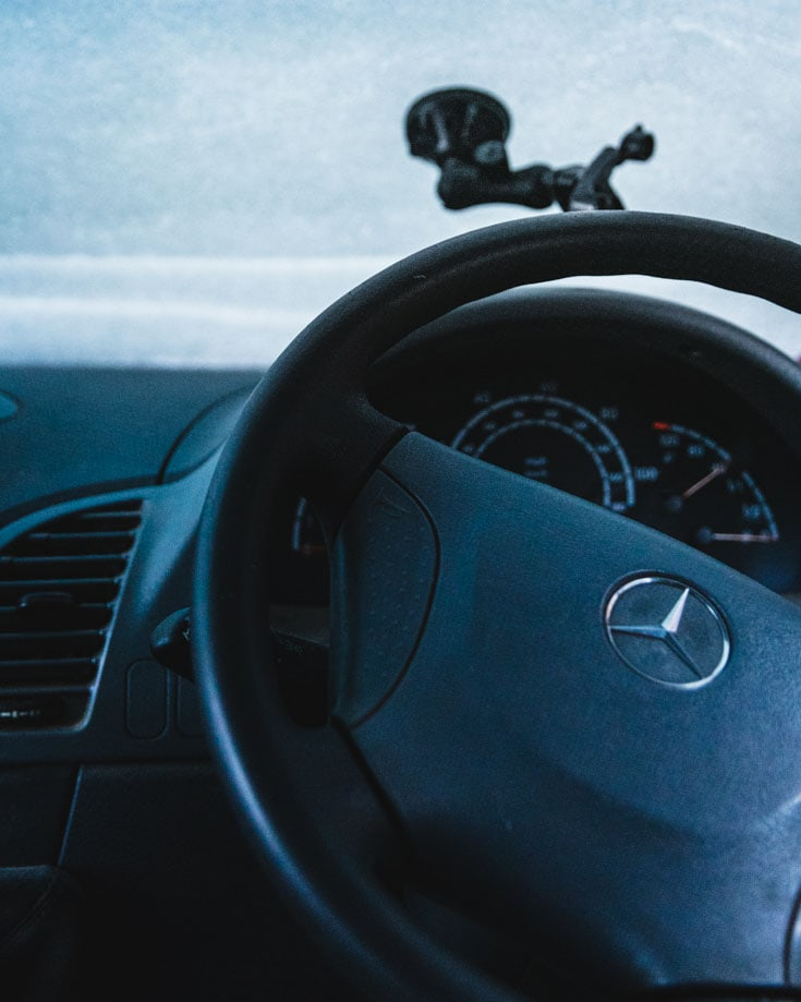 Mercedes Sprinter campervan steering wheel and snow covered windscreen