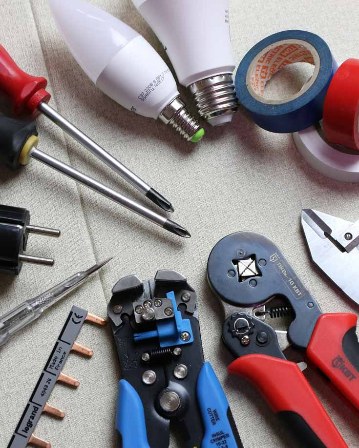 overhead photo of electrical tools laid out on a table