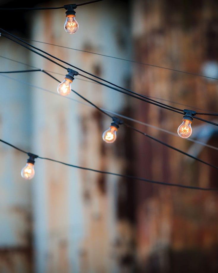 string of light bulbs hanging across a street
