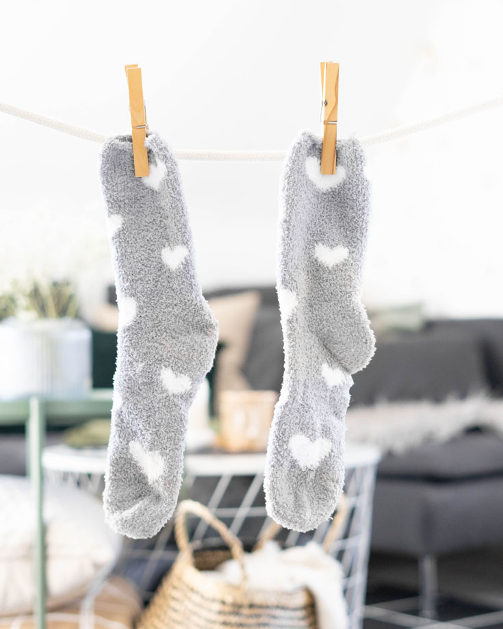 Van life laundry socks hanging on a clothes line