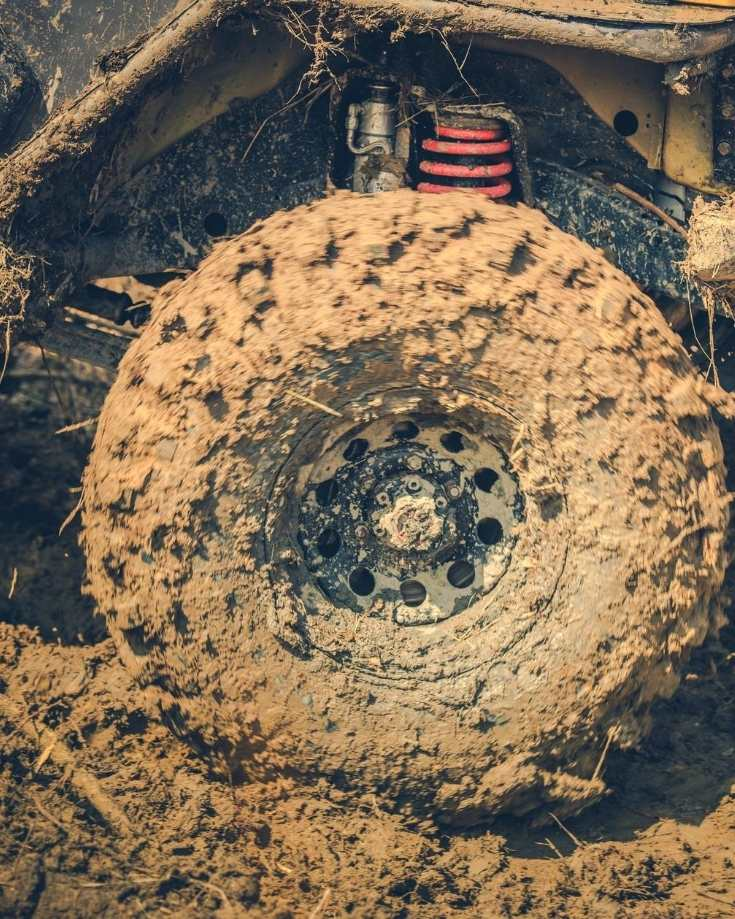 Mud covered wheel of a 4x4
