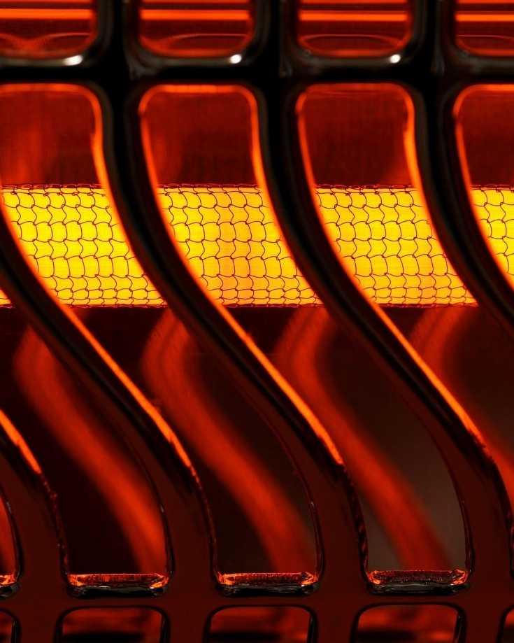 Electric heater bar glowing orange