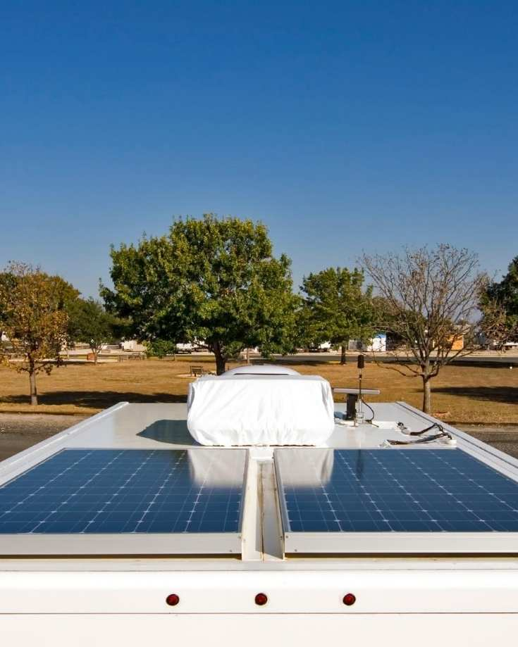 Solar panels on an RV roof with space for more
